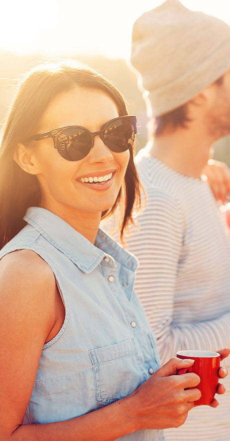 happy young woman in sun with friends enjoying Pratt Home Builders community