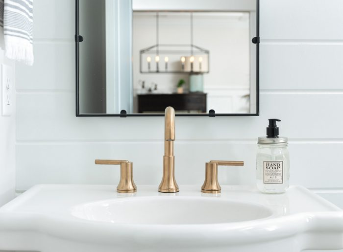 on trend brass fixtures in new home bath by Pratt Homes