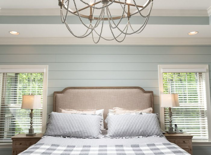 shiplap wall and stunning light fixture in master bedroom Pratt Homes