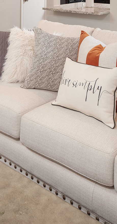 couch in new home that says live simply Heartland Cleveland by Pratt Home Builders