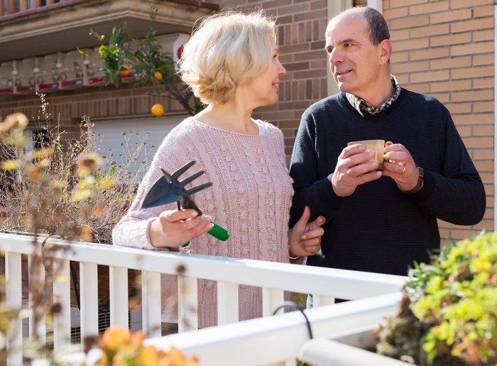 older couple talking enjoying neighbors