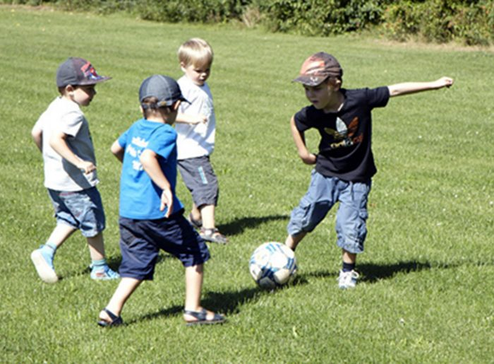 kids playing soccer at sports field in GreyHawk Trails by Pratt Home Builders